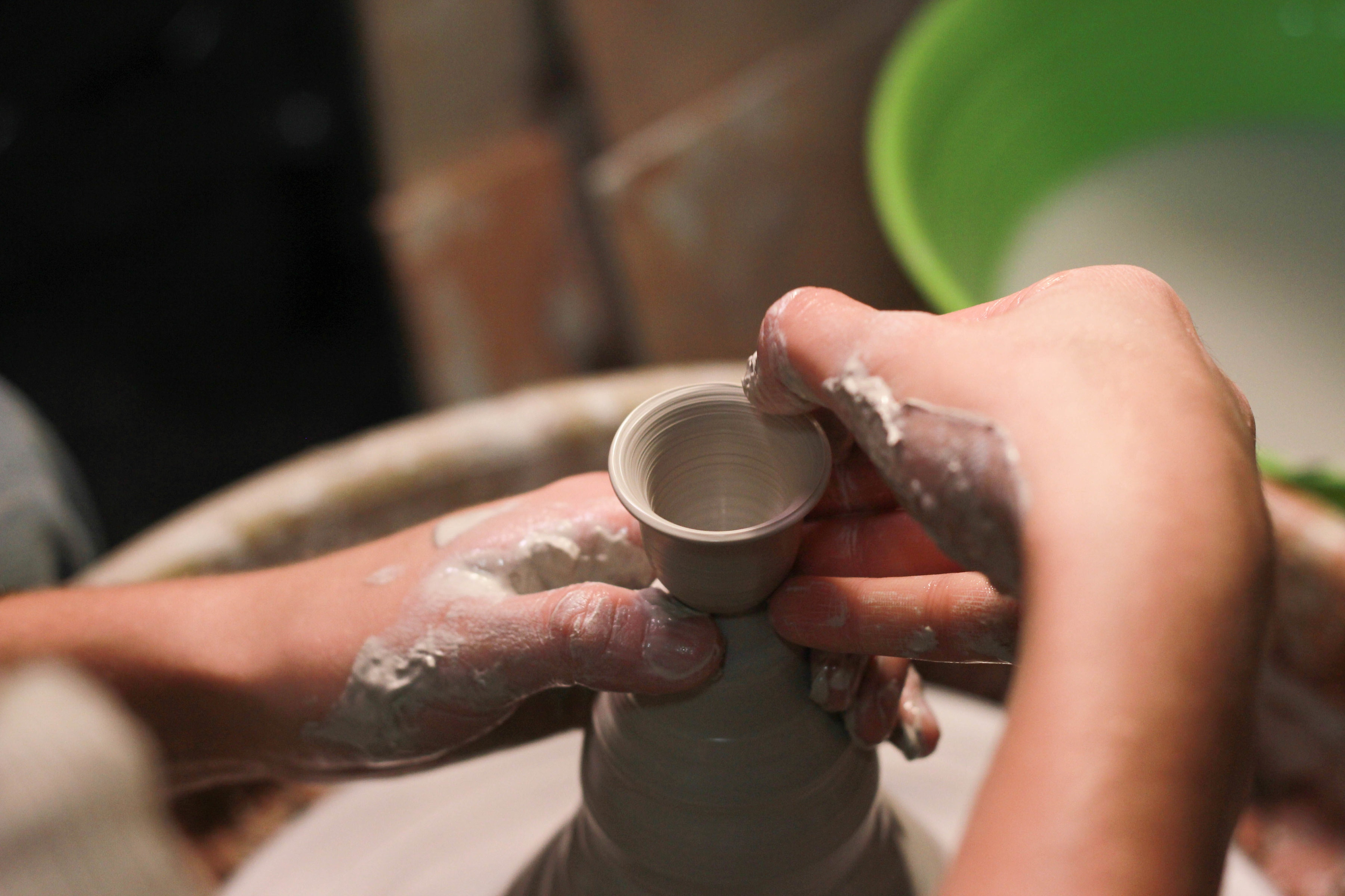Artist creating pottery