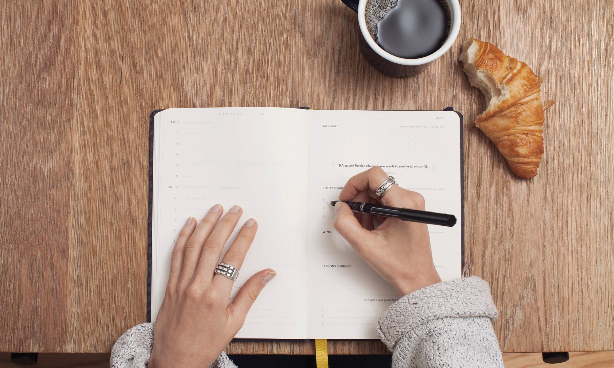 Woman Writing in a Notebook doing her business review