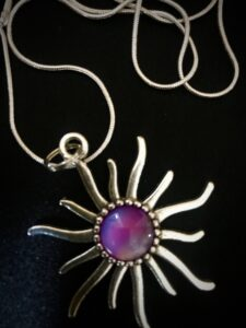 Jewelry - Silver necklace with purple sunburst